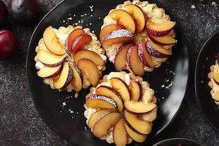 Homemade Mini Tarts with Fresh Sliced Plum Fruit